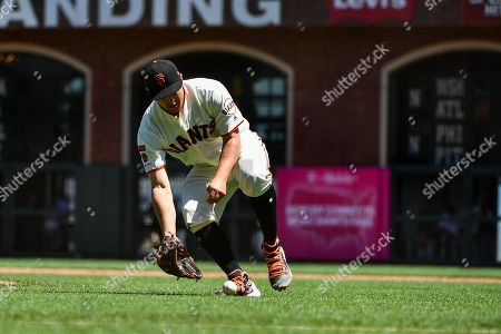 Stock Photo of San Francisco Giants starting pitcher Derek Holland (45) fields a short ground ball during the MLB game between the New York Mets and the San Francisco Giants at Oracle Park in San Francisco, CA