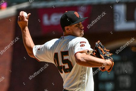 Stock Picture of San Francisco Giants starting pitcher Derek Holland (45) in action during the MLB game between the New York Mets and the San Francisco Giants at Oracle Park in San Francisco, CA