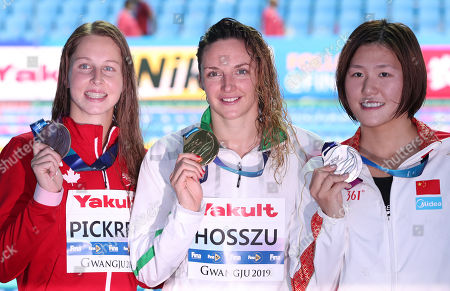 Gold medalist Katinka Hosszu (C) of Hungary, silver medalist Ye Shiwen (R) of China and bronze medalist Sydney Pickrem of Canada hold up their medals after the women's 200m individual medley final at the Gwangju 2019 FINA World Championships at Nambu University Municipal Aquatics Center in Gwangju, South Korea, 22 July 2019.