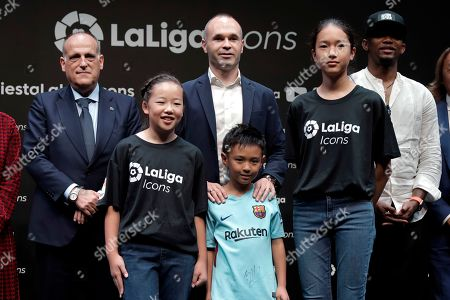 (L-R) President of the Spanish soccer league LaLiga Javier Tebas, Japanese soccer club Vissel Kobe's Spanish midfielder Andres Iniesta and former Cameroonian FC Barcelona player Samuel Eto'o pose with children during a presentation of LaLiga Icons in Tokyo, Japan, 22 July 2019. Iniesta, former FC Barcelona player, became the second LaLiga Icons ambassador. LaLiga Icons is a project by Spanish soccer league LaLiga to praise the most honorable players for achievement in Spanish soccer, with the aim of promoting LaLiga and its value globally throughout social media.