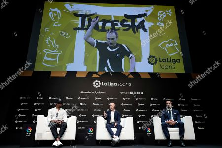 Japanese soccer club Vissel Kobe's Spanish midfielder Andres Iniesta (C) speaks while former Cameroonian FC Barcelona player Samuel Eto'o (L) and Fernando Sanz, LaLiga?s Director of International Institutional Relations and Director of the LaLiga Ambassadors and Legends Project, listen at a talk session during a presentation of LaLiga Icons in Tokyo, Japan, 22 July 2019. Iniesta, former FC Barcelona player, became the second LaLiga Icons ambassador. LaLiga Icons is a project by Spanish soccer league LaLiga to praise the most honorable players for achievement in Spanish soccer, with the aim of promoting LaLiga and its value globally throughout social media.