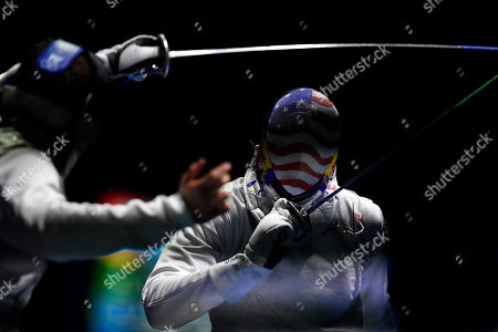 Daniel Dosa (L) of Hungary and Miles Chamley-Watson of United States fight in the men's team foil round of 16 match of the FIE World Fencing Championships in Budapest, Hungary, 22 July 2019.
