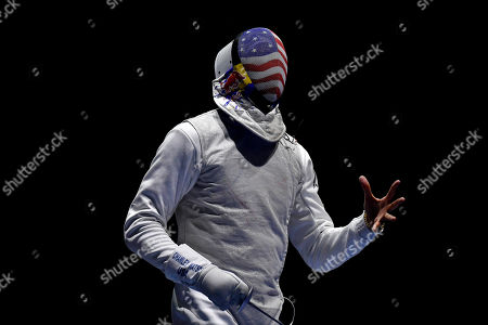 Miles Chamley-Watson of United States reacts in the men's team foil round of 16 match of the FIE World Fencing Championships against Hungary in Budapest, Hungary, 22 July 2019.