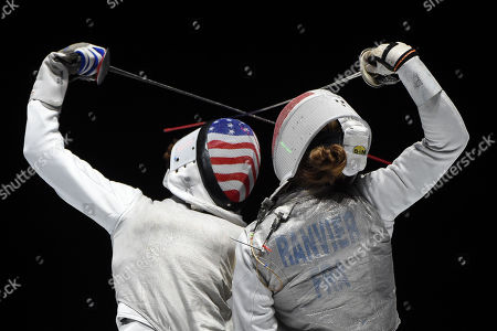 Nzingha Prescod (L) of the US fights against Pauline Ranvier of France during the US vs. France match for the third place of women's foil team competition of the FIE World Fencing Championships in Budapest, Hungary, 22 July 2019.