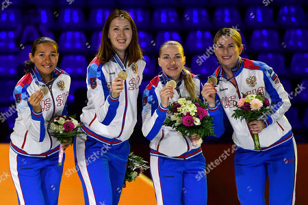 Stock Photo of Inna Deriglazova, Anastasiia Ivanova, Larisa Korobeynikova and Adelina Zagidullina of Russia celebrate with their gold medals after they defeated Italy in the final of women's foil team competition of the FIE World Fencing Championships in Budapest, Hungary, 22 July 2019.