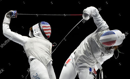 Stock Photo of Nzingha Prescod (L) of the US fights against Ysaora Thibus of France during the US vs. France match for the third place of the women's foil team competition at the FIE World Fencing Championships in Budapest, Hungary, 22 July 2019.