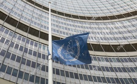 A flag is set to half mast in front of the International Atomic Energy Agency (IAEA) building in Vienna, Austria, . The IAEA announced the death of the agency's Director General Yukiya Amano at the age of 72 years