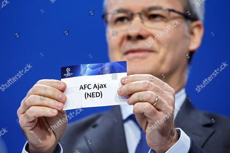 UEFA deputy secretary general Giorgio Marchetti shows the lot of The Netherlands club AFC Ajax, during thedraw of the matches for the Champions League 2019/20 third qualifying round, at the UEFA headquarters in Nyon, Switzerland, 22 July 2019.