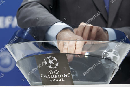 UEFA deputy secretary general Giorgio Marchetti removes the balls containing the names of the soccer club, during the draw of the matches for the Champions League 2019/20 third qualifying round, at the UEFA headquarters in Nyon, Switzerland, 22 July 2019.