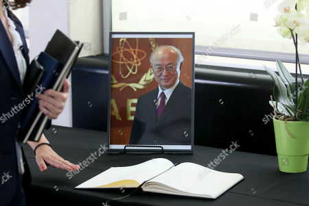 A book of condolence in front of a portrait photo of the Director General of the International Atomic Energy Agency, IAEA, Yukiya Amano from Japan is positioned in Vienna, Austria, . The IAEA announced the death of the agency's Director General Yukiya Amano at the age of 72 years