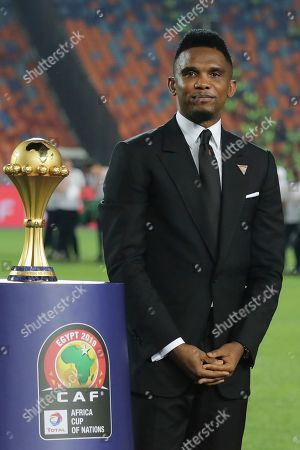 Cameroon's soccer star Samuel Eto'o display the trophy before the African Cup of Nations final soccer match between Algeria and Senegal in Cairo International stadium in Cairo, Egypt