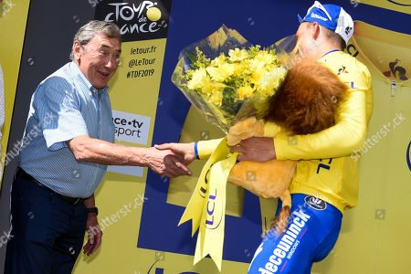 Stock Picture of Julian Alaphilippe (FRA) pictured being congratulated by Eddy Merckx on the podium as he retains the general individual classification yellow jersey after finishing in second place the Tour de France cycling race fourteenth stage over 117,5 kilometers (73 miles) with start in Tarbes and finish at Tourmalet