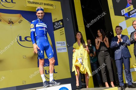 Julian Alaphilippe (FRA) pictured celebrating on the podium as he retains the general individual classification yellow jersey after finishing in second place the Tour de France cycling race fourteenth stage over 117,5 kilometers (73 miles) with start in Tarbes and finish at Tourmalet