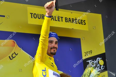 Stock Photo of Julian Alaphilippe (FRA) pictured celebrating on the podium as he retains the general individual classification yellow jersey after finishing in second place the Tour de France cycling race fourteenth stage over 117,5 kilometers (73 miles) with start in Tarbes and finish at Tourmalet