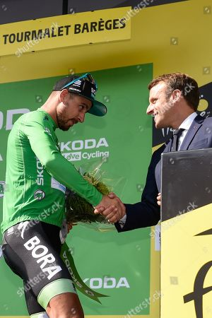French President Emmanuel Macron pictured congratulating Peter Sagan (SVK) during podium ceremony at as he retains the points classification green jersey Tourmalet after Tour de France cycling race fourteenth stage