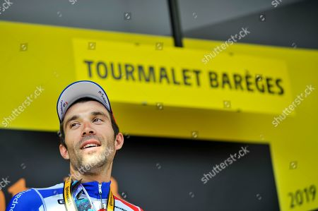 Thibaut Pinot (FRA) pictured celebrating on the podium after winning the Tour de France cycling race fourteenth stage over 117,5 kilometers (73 miles) with start in Tarbes and finish at Tourmalet