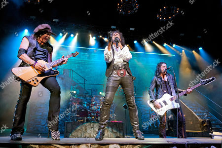 Alice Cooper, Ryan Roxie, Chuch Garric. Ryan Roxie, from left, Alice Cooper and Chuck Garric perform at the Hollywood Casino Amphitheatre, in Chicago