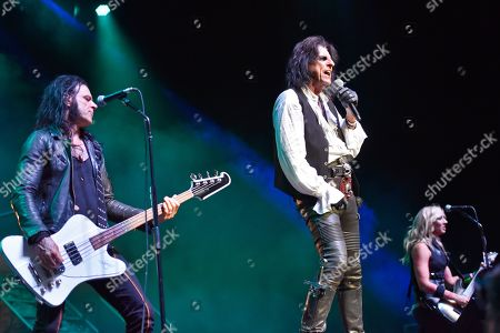 Alice Cooper, Nita Strauss, Chuch Garric. Chuck Garric, from left, Alice Cooper and Nita Strauss perform at the Hollywood Casino Amphitheatre, in Chicago