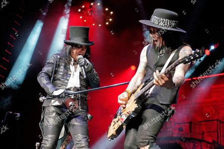 Alice Cooper, Tommy Henriksen. Alice Cooper, left, and Tommy Henriksen perform at the Hollywood Casino Amphitheatre, in Chicago
