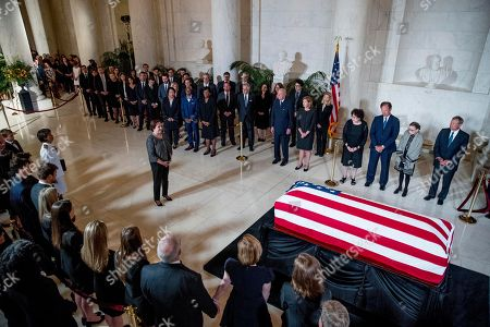Associate Justice Elena Kagan, center left, speaks at a private ceremony in the Great Hall of the Supreme Court in Washington, where late Supreme Court Justice John Paul Stevens lies in repose. Also pictured at right is retired Associate Justice Anthony Kennedy, Ashley Kavanaugh, the wife of Associate Justice Brett Kavanaugh, Associate Justice Sonia Sotomayor, Associate Justice Samuel Alito, Associate Justice Ruth Bader Ginsburg, and Chief Justice John Roberts