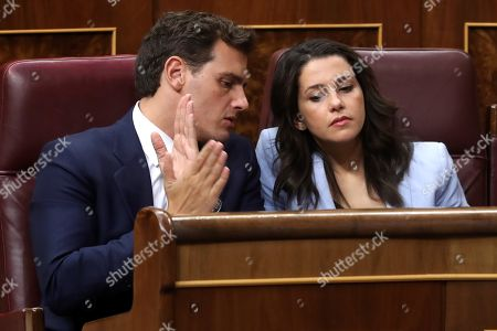 Leader of Ciudadanos, Albert Rivera (L), talks with spokeswoman of Ciudadanos party, Ines Arrimadas (R), during the first session of the investiture debate at the Parliament's Lower Chamber in Madrid, Spain, 22 July 2019. Spanish acting Prime Minister Pedro Sanchez faces an investiture debate that could lead to his election as the Prime Minister of the first coalition Government of Spain if a deal with left-wing coalition Unidas Podemos (UP) is reached. The investiture debate comes about three months after the general elections in Spain, in which Sanchez obtained 123 seats. Sanchez will need an absolute majority with 176 votes in the first vote scheduled 23 July to be successful. Otherwise, a second vote will be held on the upcoming 25 July in which it's only required a simple majority.