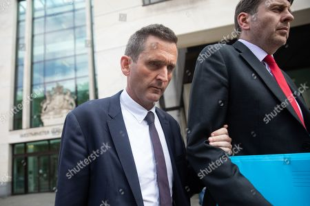 Chris Holmes - Baron Holmes of Richmond (left) leaves Westminster Magistrates' Court where he appeared on charges of sexual assault.