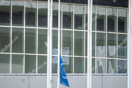 A IAEA flag flies at a half mast at the International Atomic Energy Agency (IAEA) headquarters at the IAEA headquarters of the United Nations (UN) seat in Vienna, Austria, 22 July 2019. The International Atomic Energy Agency (IAEA) on 22 July 2019 announced their Director General Yukiya Amano has died on 22 July 2019 at the age of 72.