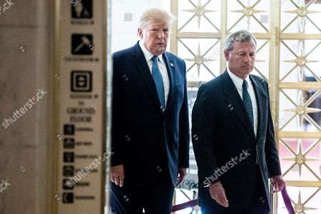 US President Donald J. Trump (L) and Chief Justice John Roberts (R) walk together as the late US Supreme Court Justice John Paul Stevens lies in repose in the Great Hall of the Supreme Court.
