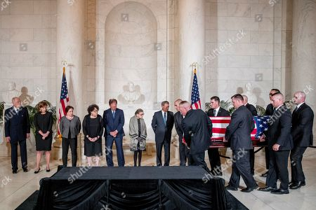 From left, retired Associate Justice Anthony Kennedy, Ashley Kavanaugh, the wife of Associate Justice Brett Kavanaugh, Associate Justice Elena Kagan, Associate Justice Judge Sonia Sotomayor, Associate Justice Samuel Alito, Associate Justice Ruth Bader Ginsburg, and Chief Justice John Roberts watch as the casket of late Supreme Court Justice John Paul Stevens is carried into the Great Hall of the Supreme Court in Washington