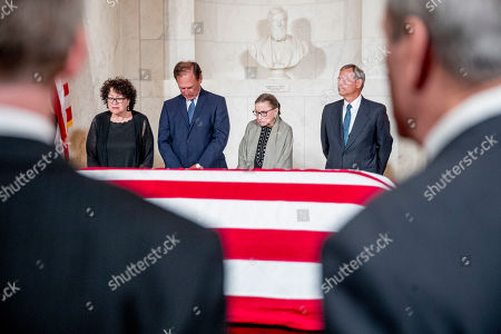 From left, Associate Justice Judge Sonia Sotomayor, Associate Justice Samuel Alito, Associate Justice Ruth Bader Ginsburg, and Chief Justice John Roberts participates in a moment of silence during a private ceremony in the Great Hall of the Supreme Court in Washington