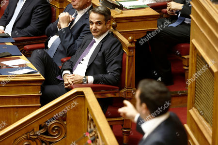 Greek Prime Minister Kyriakos Mitsotakis (L) attends the speech of leader of the main opposition party SYRIZA Alexis Tsipras (R), during a debate on the vote of confidence in the government, in the parliament's plenum, in Athens, Greece, 22 July 2019.