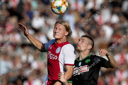 Ajax Amsterdam player Kasper Dolberg (L) in action against Panathinaikos player Dimitros Koloretsios during a friendly match in the Olympic Stadium in Amsterdam, The Netherlands, 22 July 2019.