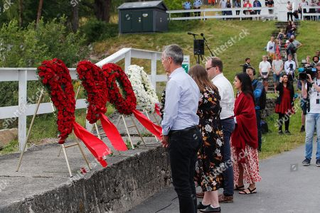 NATO Secretary General Jens Stoltenberg (L) lays a wreath during the memorial ceremony for the victims killed in the 2011 Norway attack at Utoya Island, Norway, 22 July 2019. Norway marks the eighth anniversary of the bombing of the government buildings in Oslo and the shooting at a summer camp on Utoya island, in which 77 people were killed on 22 July 2011. Convicted Norwegian right-wing extremist Anders Behring Breivik is serving a 21-year sentence for the terrorist attacks.