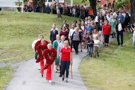 Stock Picture of People attend the memorial ceremony for the victims killed in the 2011 Norway attack at Utoya Island, Norway, 22 July 2019. Norway marks the eighth anniversary of the bombing of the government buildings in Oslo and the shooting at a summer camp on Utoya island, in which 77 people were killed on 22 July 2011. Convicted Norwegian right-wing extremist Anders Behring Breivik is serving a 21-year sentence for the terrorist attacks.
