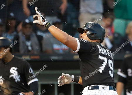 Chicago White Sox's Jose Abreu points into the stands after scoring on his two-run home run off Miami Marlins starting pitcher Trevor Richards during the third inning of a baseball game, in Chicago. Jon Jay also scored on the play