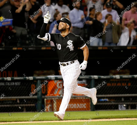 Chicago White Sox's Yoan Moncada celebrates his three-run home run off Miami Marlins starting pitcher Trevor Richards during the fifth inning of a baseball game, in Chicago. Leury Garcia and Jose Abreu also scored