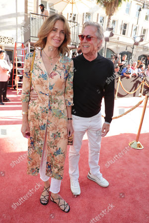 """Kelley Phleger and Don Johnson at the Premiere of Sony Pictures """"Once Upon A Time In Hollywood"""" at the TCL Chinese Theatre."""