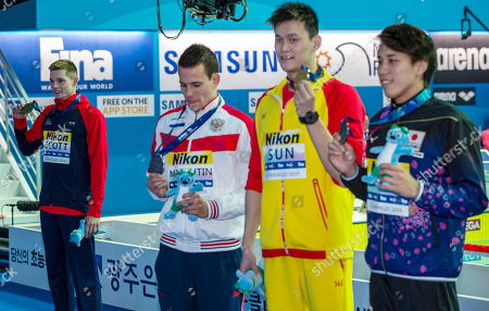 Gold medalist (R) Sun Yang of China, silver medalist Katsuhiro Matsumoto (2-L) of Japan and joint bronze medal winners Martin Malyutin (2-R) of Russia and Duncan Scott (L) of Great Britain during the medal ceremony for the men's 200m Freestyle final of the swimming competitions at the Gwangju 2019 Fina World Championships, Gwangju, South Korea, 23 July 2019.