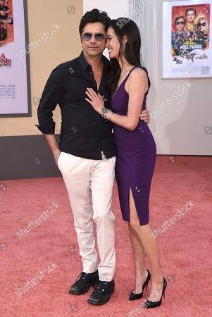 """John Stamos, Caitlin McHugh. John Stamos and Caitlin McHugh arrive at the Los Angeles premiere of """"Once Upon a Time in Hollywood"""" at the TCL Chinese Theatre on"""