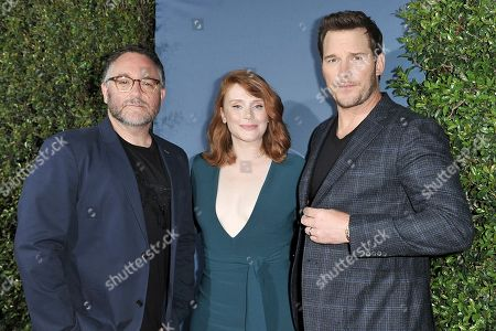 "Stock Picture of Colin Trevorrow, Bryce Dallas Howard, Chris Pratt. Colin Trevorrow, from left, Bryce Dallas Howard, left, and Chris Pratt attend ""Jurassic World: The Ride"" grand opening celebration at Universal Studios, in Universal City, Calif"