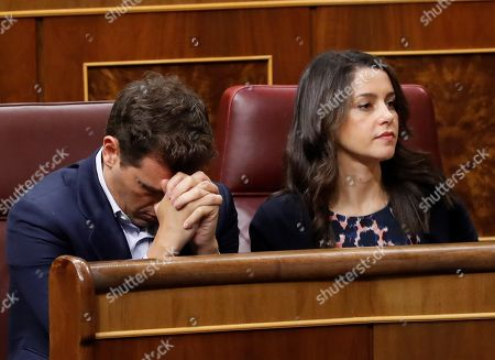 Leader of Ciudadanos party, Albert Rivera (L), and Ciudadanos' spokesperson in the Congress, Ines Arrimadas (R), during the second day of the investiture debate at the Parliament's Lower Chamber, in Madrid, Spain, 23 July 2019. Lawmakers are to decide whether to confirm Socialist Party's candidate Pedro Sanchez as Prime Minister in the first round of the investiture vote, in which an absolute majority is needed. In the most likely case of a failed result, Sanchez would require a simple majority in a second round of voting that will take place on the upcoming 25 July.