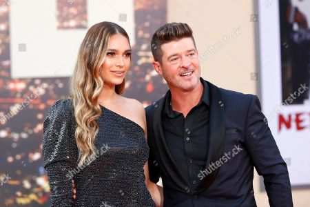 April Love Geary and US-Canadian singer Robin Thicke arrive for the premiere of 'Once Upon a Time in Hollywood' at the TCL Chinese Theatre IMAX in Hollywood, Los Angeles, California, USA, 22 July 2019. The movie opens in the US on 26 July.