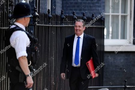 Britain's Secretary of State for International Trade and President of the Board of Trade Liam Fox (R) arrives for a cabinet meeting in 10 Downing Street, Central London, Britain, 23 July 2019. The conclusion of the Conservative party leadership contest between Boris Johnson and Jeremy Hunt will be announced later in the day with the winner replacing Theresa May as British Prime Minister.