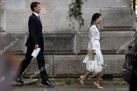 Foreign Secretary Jeremy Hunt (L) and his wife Lucia Hunt (R) leave the Foreign Office in Central London, Britain, 23 July 2019. The conclusion of the Conservative party leadership contest between Boris Johnson and Jeremy Hunt will be announced later in the day with the winner replacing Theresa May as British Prime Minister.