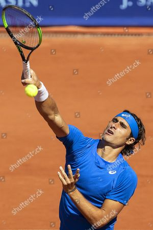 Gian Marco Moroni of Italy in action against Tommy Robredo of Spain during their first round match of the Swiss Open tennis tournament in Gstaad, Switzerland, 23 July 2019.