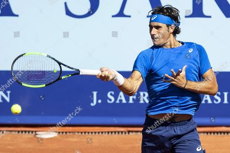 Stock Photo of Gian Marco Moroni of Italy in action against Tommy Robredo of Spain during their first round match of the Swiss Open tennis tournament in Gstaad, Switzerland, 23 July 2019.
