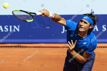 Stock Image of Gian Marco Moroni of Italy in action against Tommy Robredo of Spain during their first round match of the Swiss Open tennis tournament in Gstaad, Switzerland, 23 July 2019.