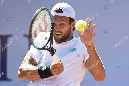 Joao Sousa of Portugal in action against Steve Darcis of Belgium during their first round match of the Swiss Open tennis tournament in Gstaad, Switzerland, 23 July 2019.