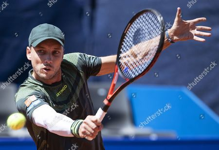 Steve Darcis of Belgium in action against Joao Sousa of Portugal during their first round match of the Swiss Open tennis tournament in Gstaad, Switzerland, 23 July 2019.
