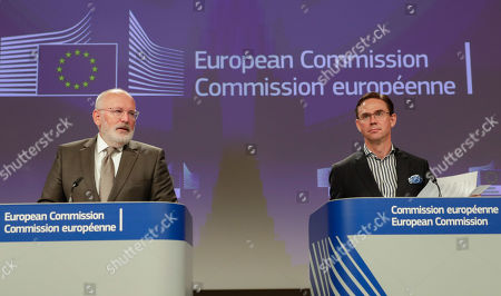 Stock Image of Dutch Frans Timmermans (L), First Vice President of the European Commission and Commissioner for Better Regulation, Inter-Institutional Relations, Rule of Law and Charter of Fundamental Rights, together with Finnish Jyrki Katainen, European Commissioner for Jobs, Growth, Investment and Competitiveness, hold a joint press conference on protecting and restoring the world's forests at the European Commission in Brussels, Belgium, 23 July 2019.